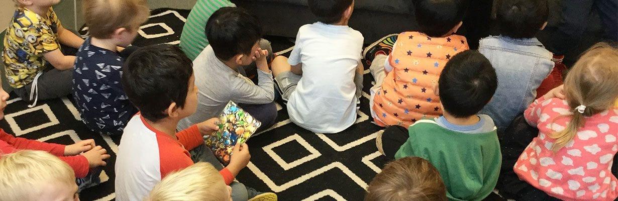 Children sitting on floor listening to Autism talk at Guardian Roseville