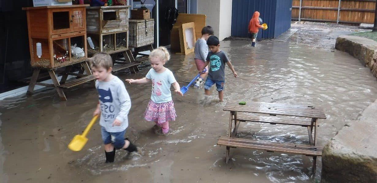 children walking in deep water at Guardian Bruce