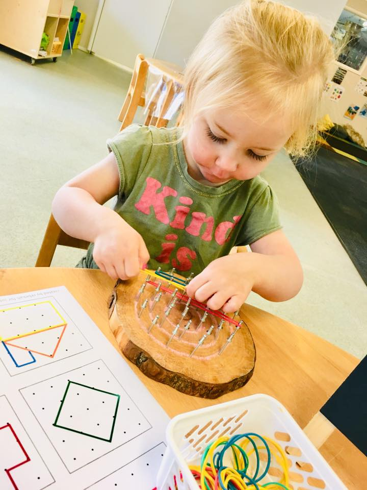 child building geoboards at Eastwood