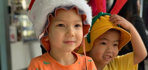children raising money for farmers at Christmas BBQ