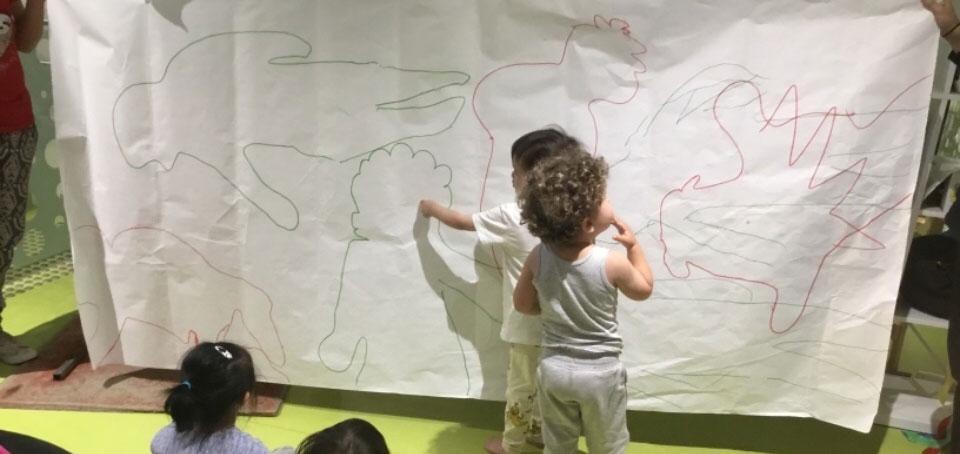 children exploring shadows, science and movement at Summer Rain program