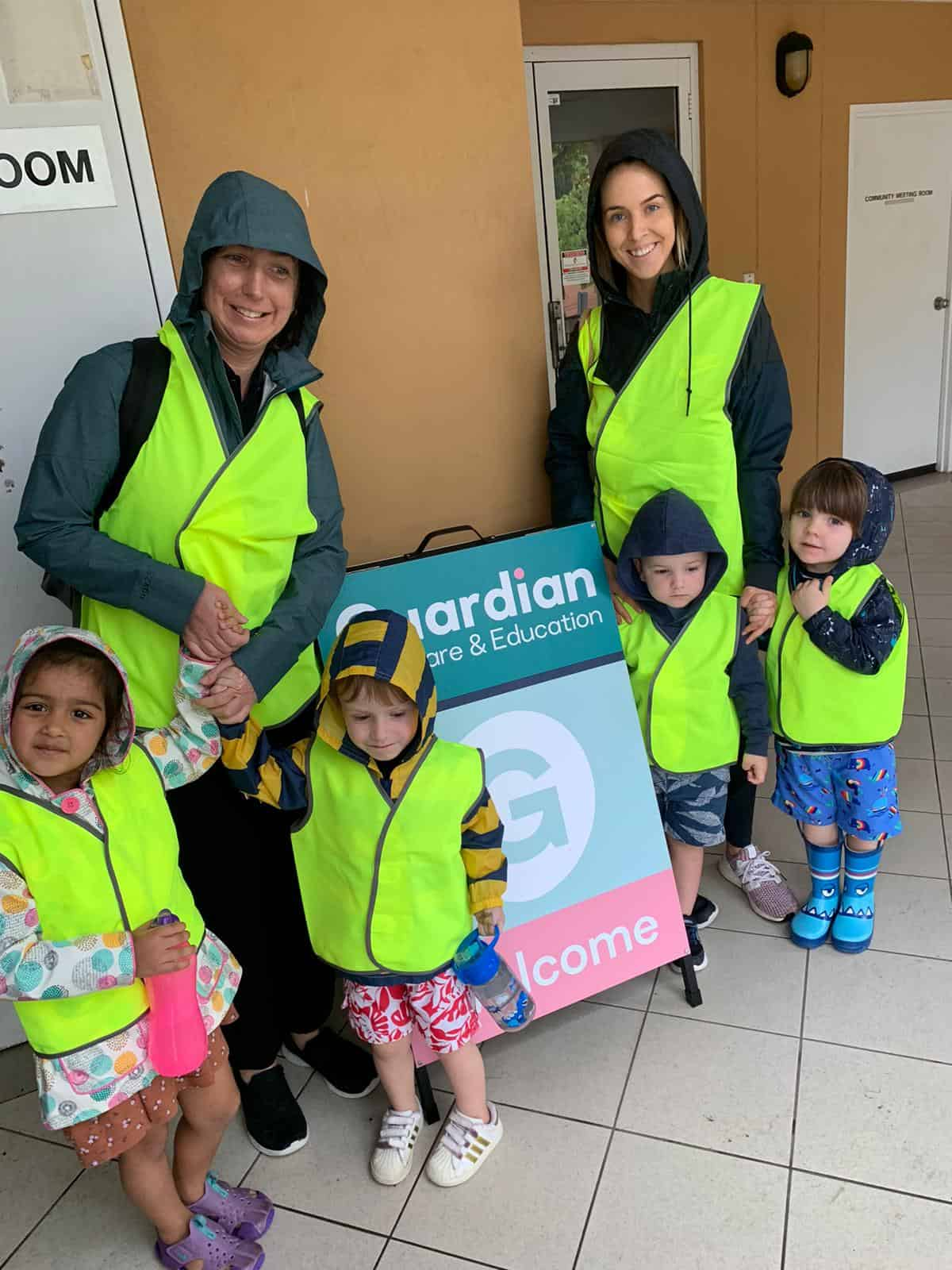 Children and Educators in Guardian safety vests, on way to first swimming lesson