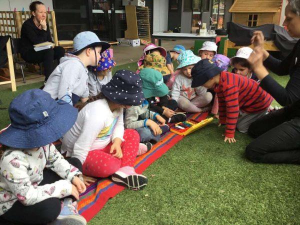 children exploring colour and rainbow through song