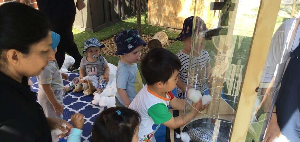 Guardian Mckinnon children exploring wind during Summer Rain program