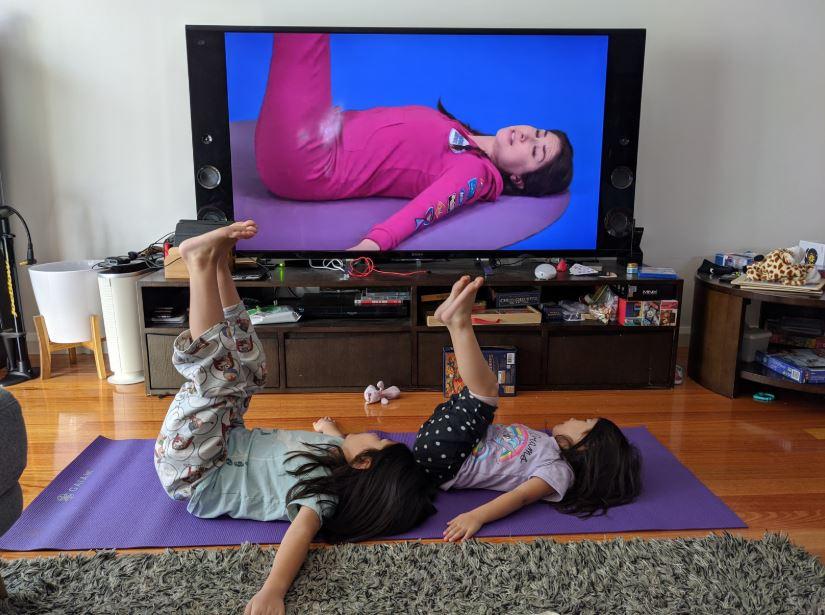 Children do yoga together