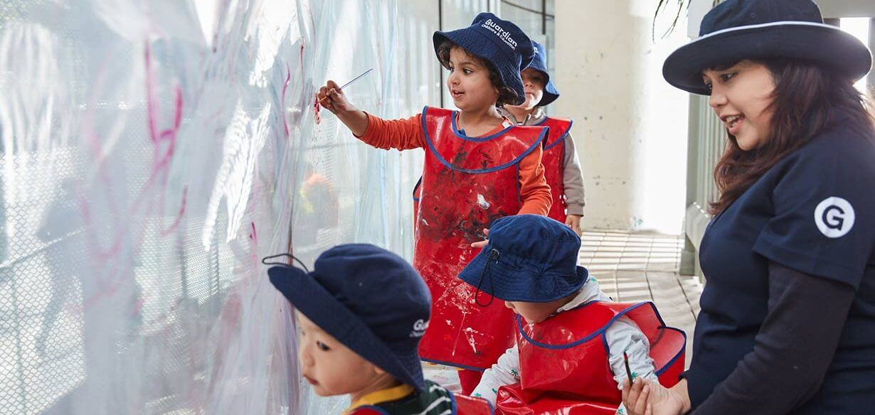 Children from Guardian Bligh St painting